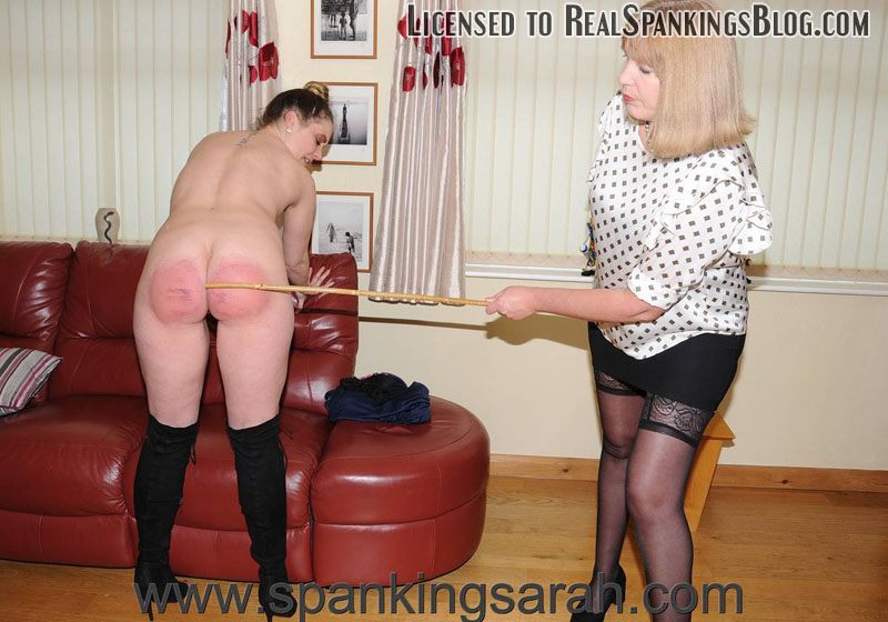 Making Amends with a Caning - Sarah Stern gives her cleaner a severe bare bottom caning