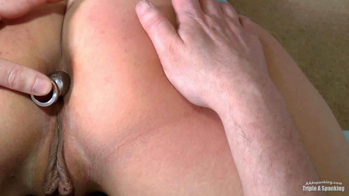 Exposed Wet Butt Plugged Spanked: Sarah gets an OTK bare bottom spanking in the humiliating wheelbarrow position that fully exposes her pussy and anus