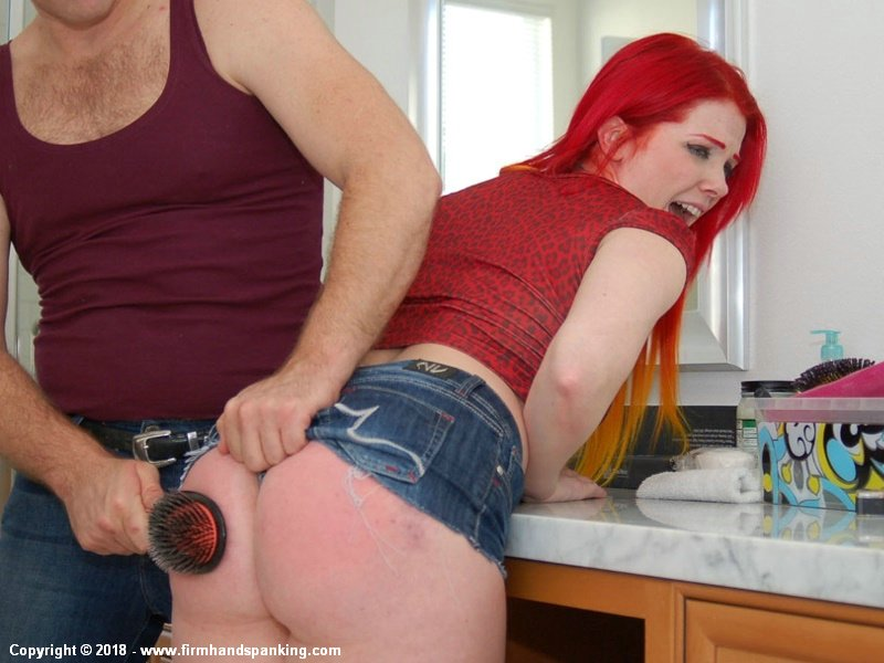 A hairbrush spanking turns her bottom bare bottom a deep shade of flaming red.